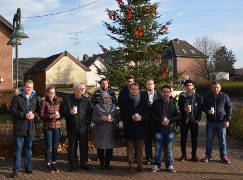Rommerskirchener und Flüchtlinge gedenken gemeinsam den Opfern des Berliner Anschlags